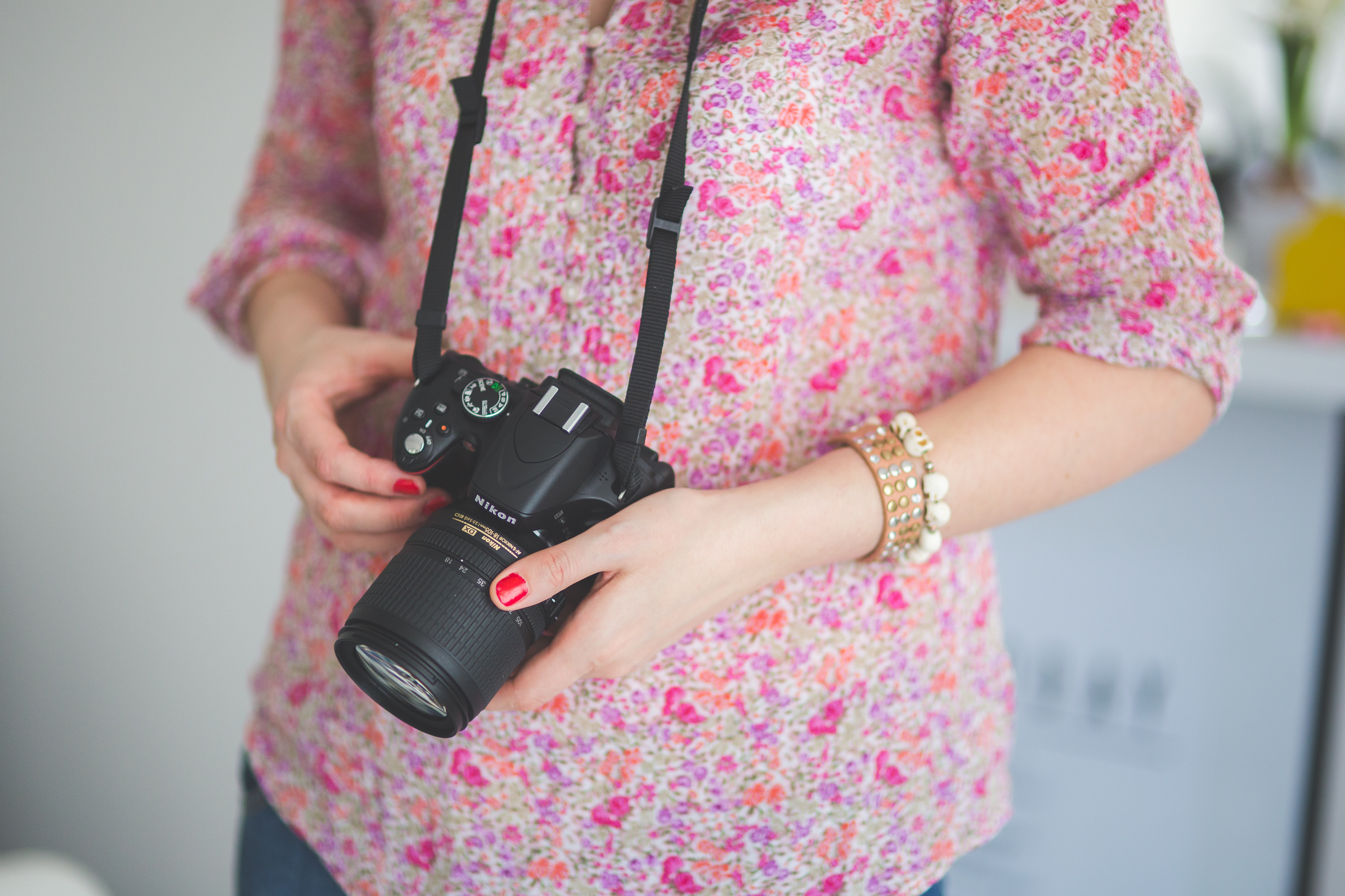 womn holding camera photography