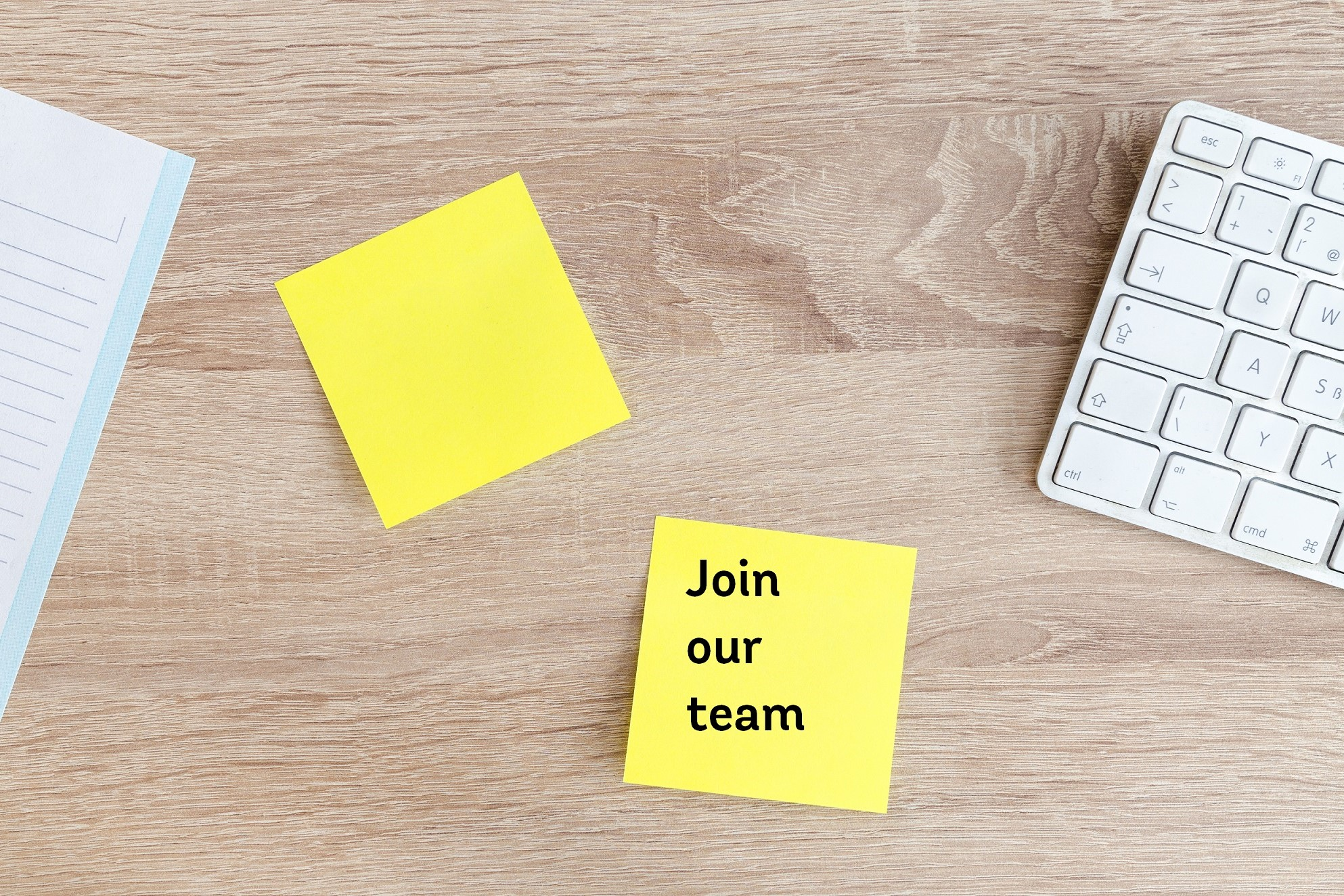 join our team post it note at desk to work with us in an office team