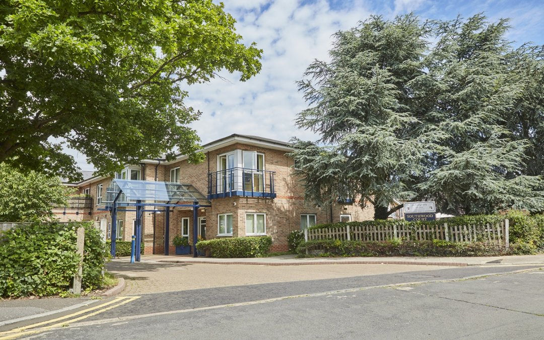 sheltered home outside building with nice trees in essex